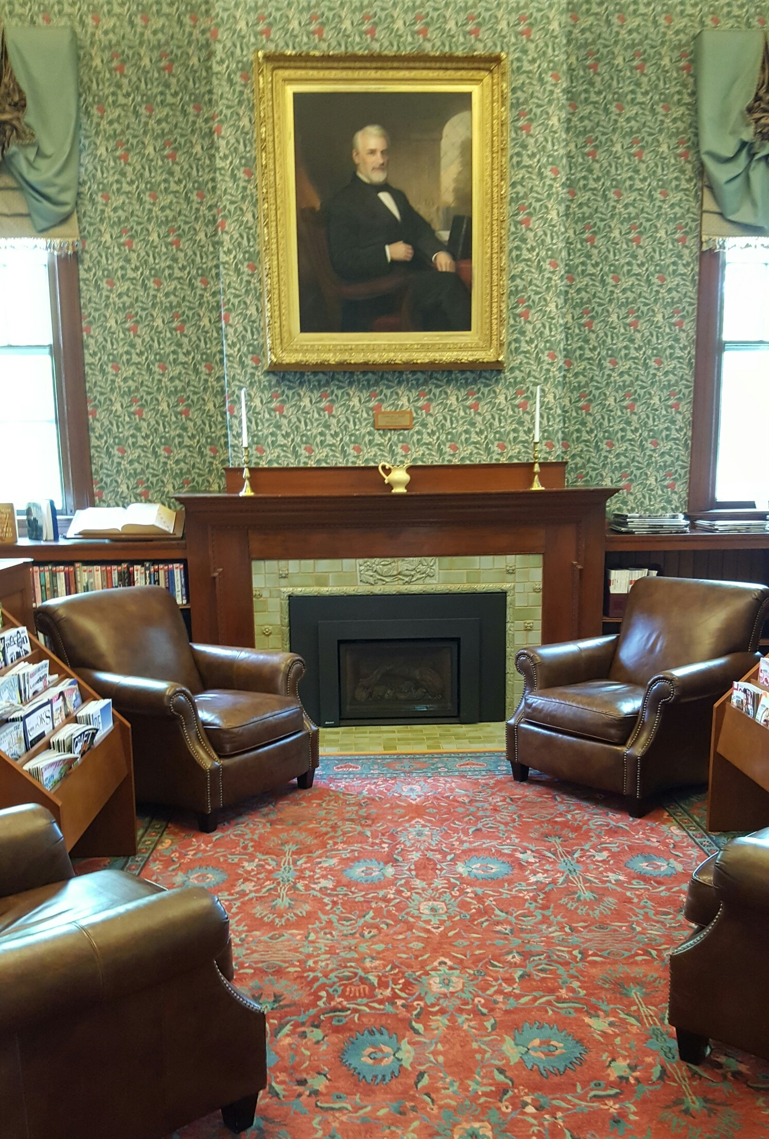 A portrait of Charles Flint hangs in the Library Reading Room